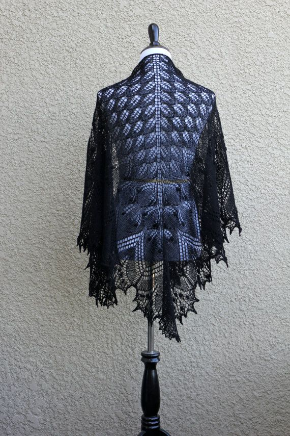 Knit shawl, knit wrap in black lace is made of 50% merino/50% tencel in a magic…
