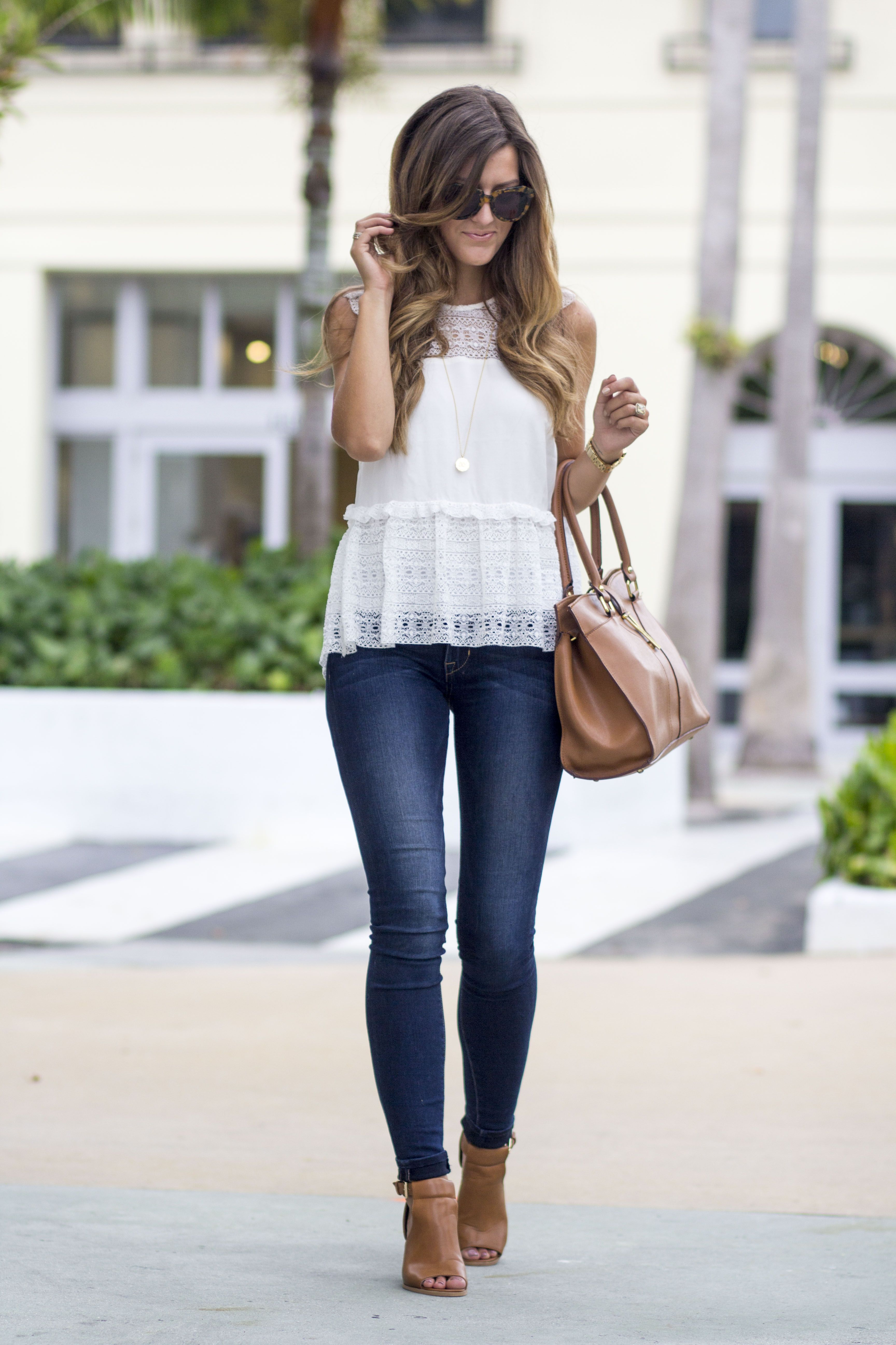 Too tight jeans, overdone hair, gigantic designer bag, and zero originality 9b10a528dd5