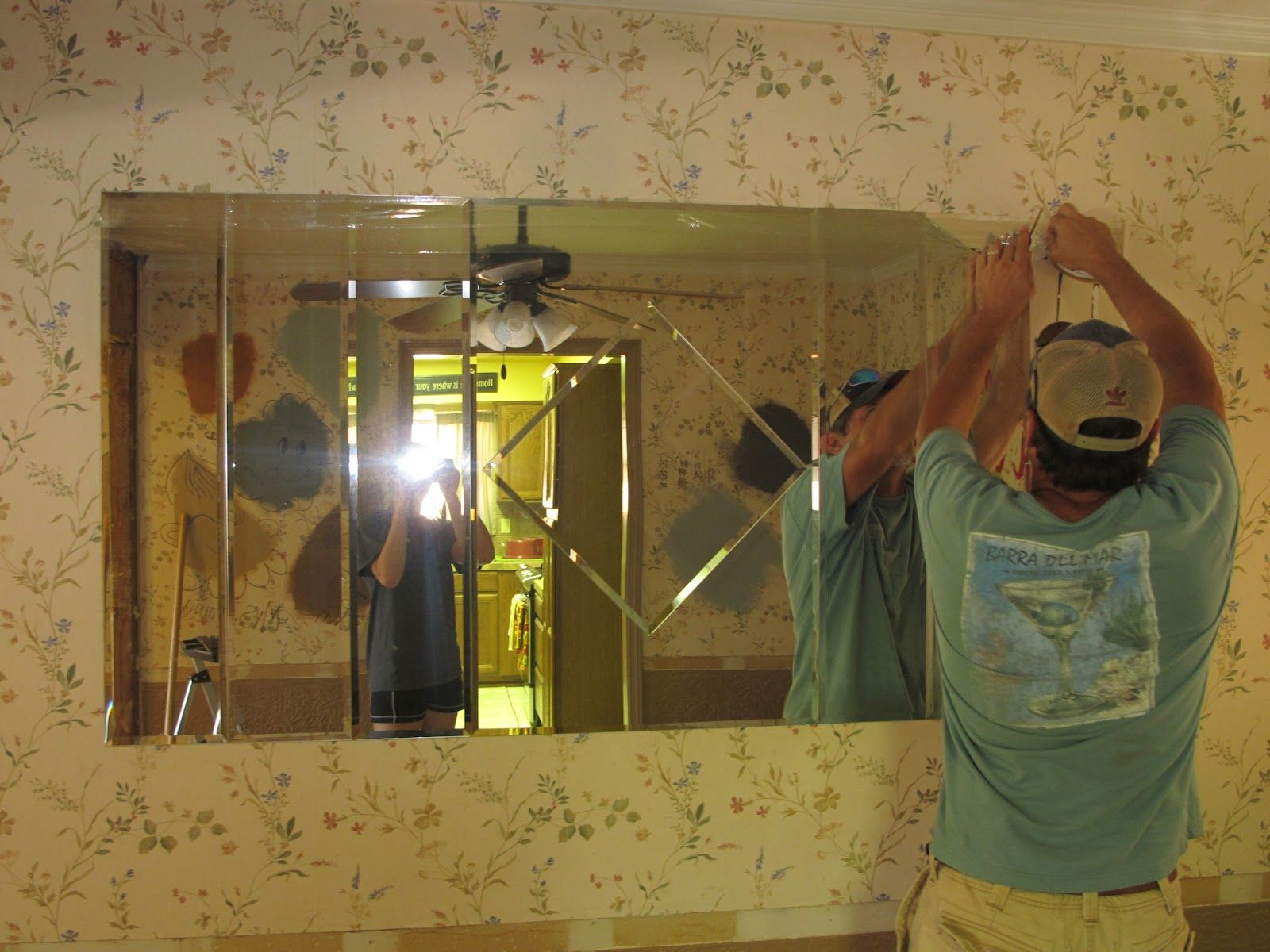 How to remove a mirror glued on the wall mirror glue