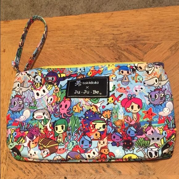 Tokidoki Sea Amo Quicklet In excellent used condition. I absolutely love this print and this makes the perfect wristlet! tokidoki Bags Clutches & Wristlets