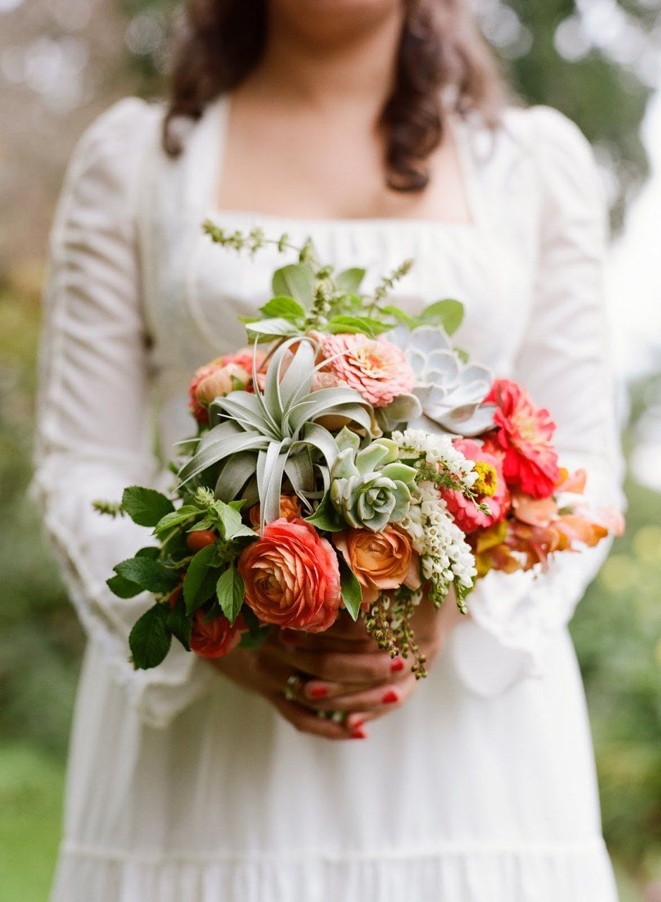 Love the succulents and ranunculus in this bouquet! (With