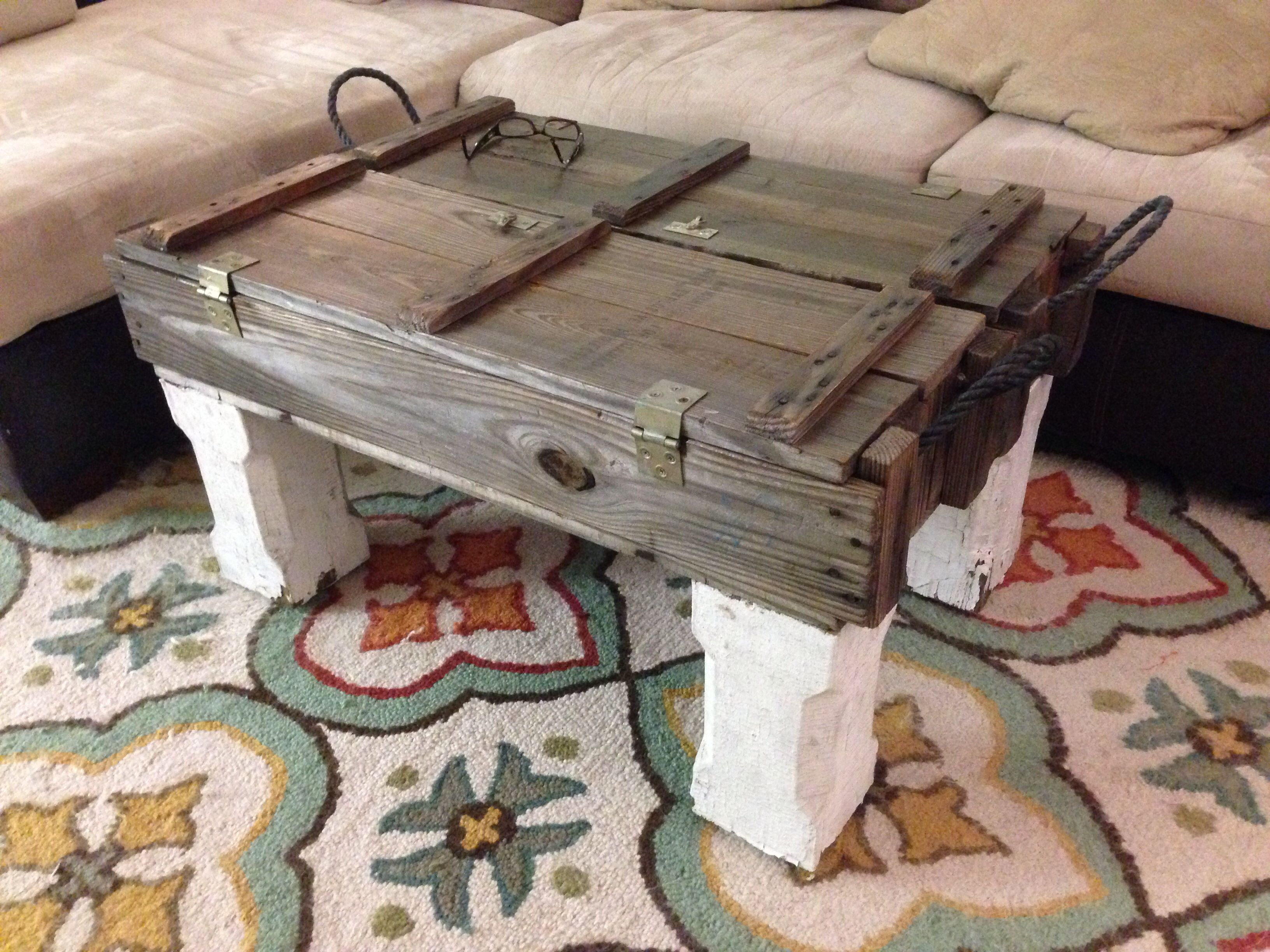 New ammo box coffee table with legs made from porch posts from