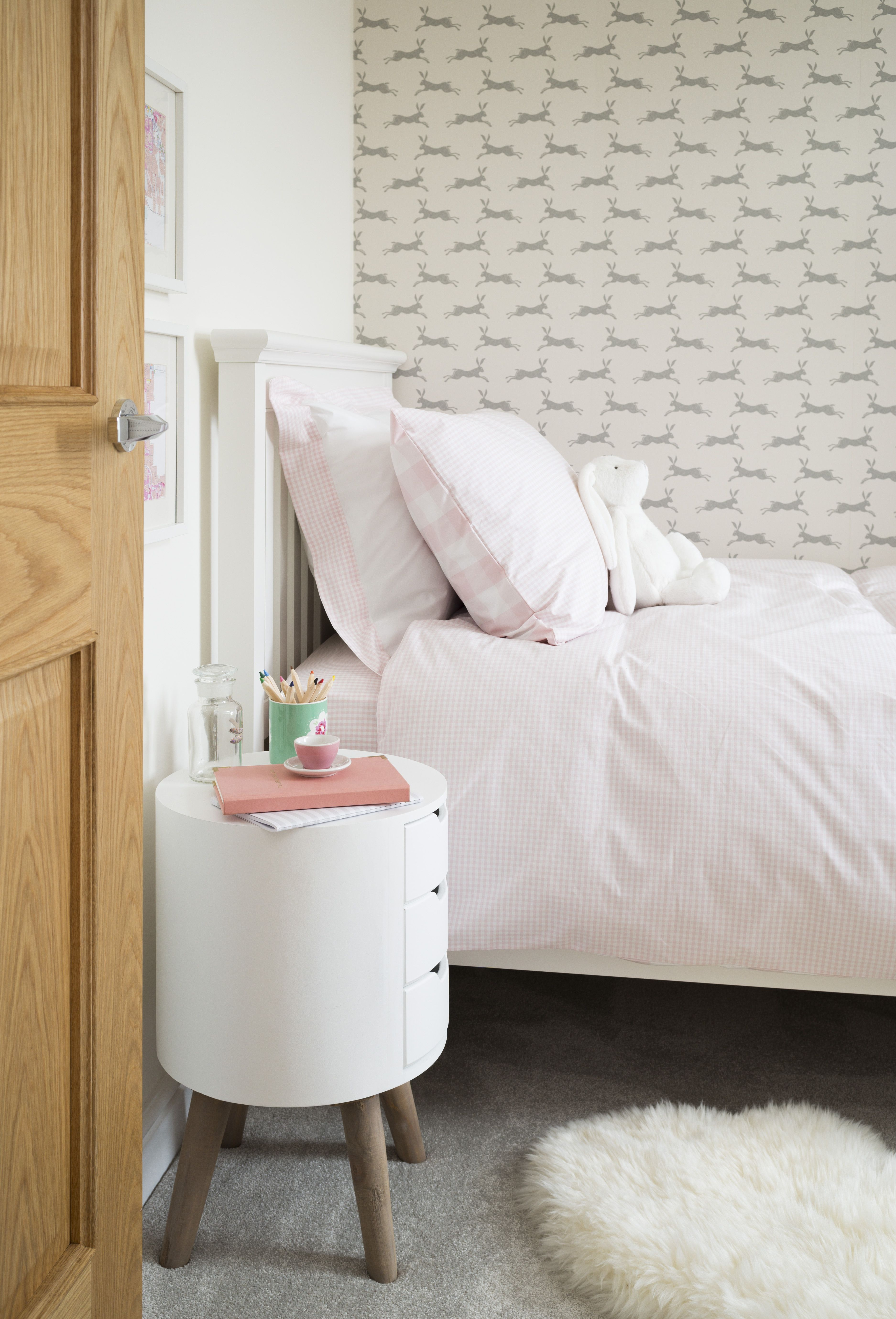 Plush grey carpets and soft pink accessories are perfect for ...