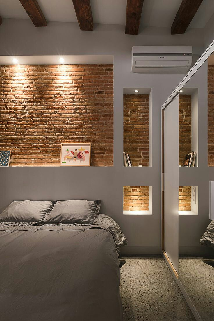 Cabecero ladrillos, selectively exposed brick in bedroom.