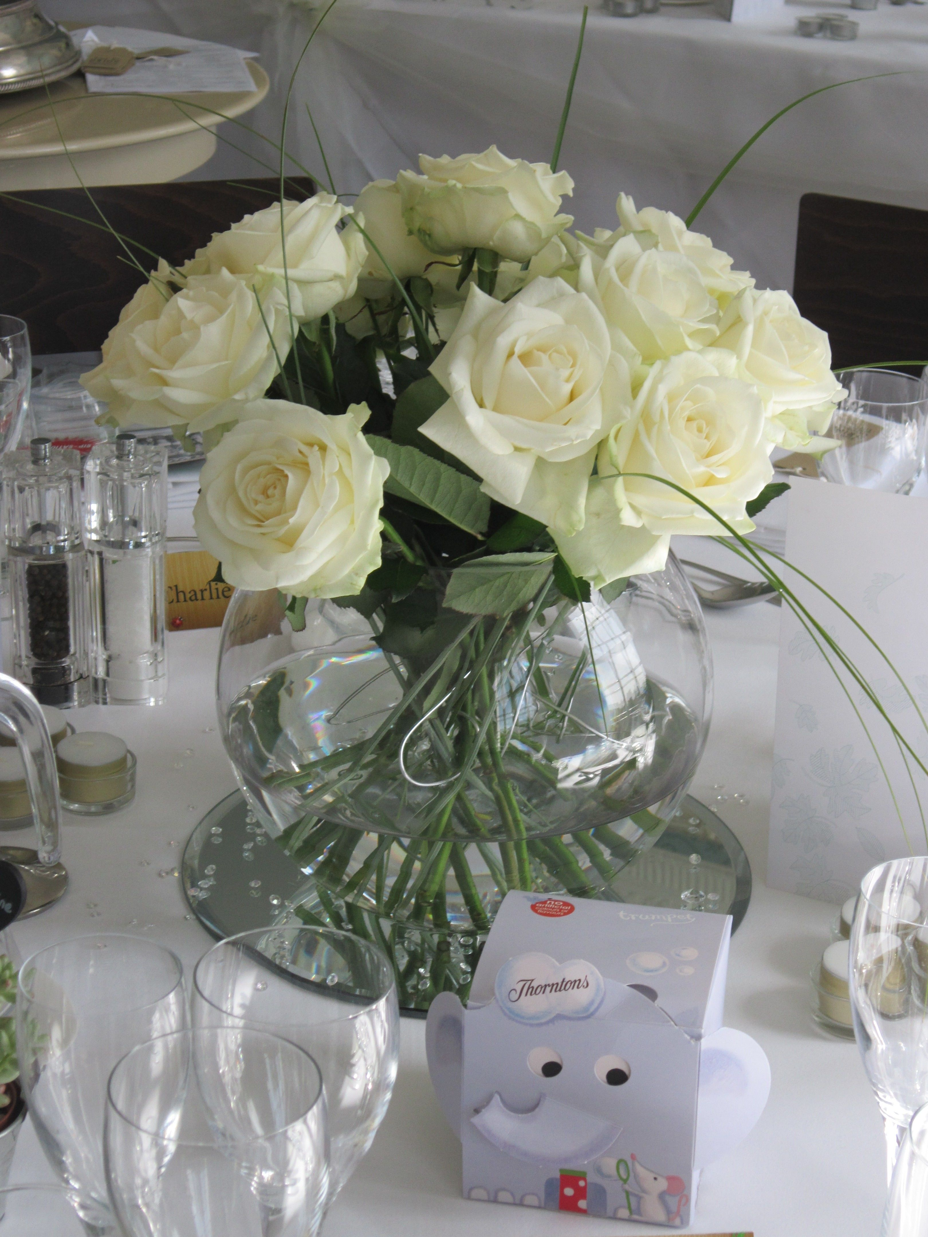 Fishbowl vase with white roses and beargrass flowers