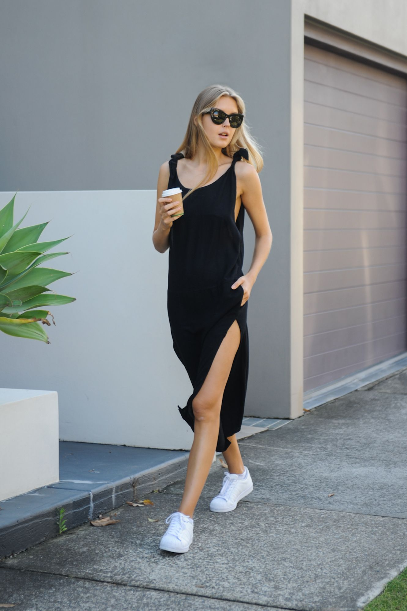 Black dress with adidas shoes - Source