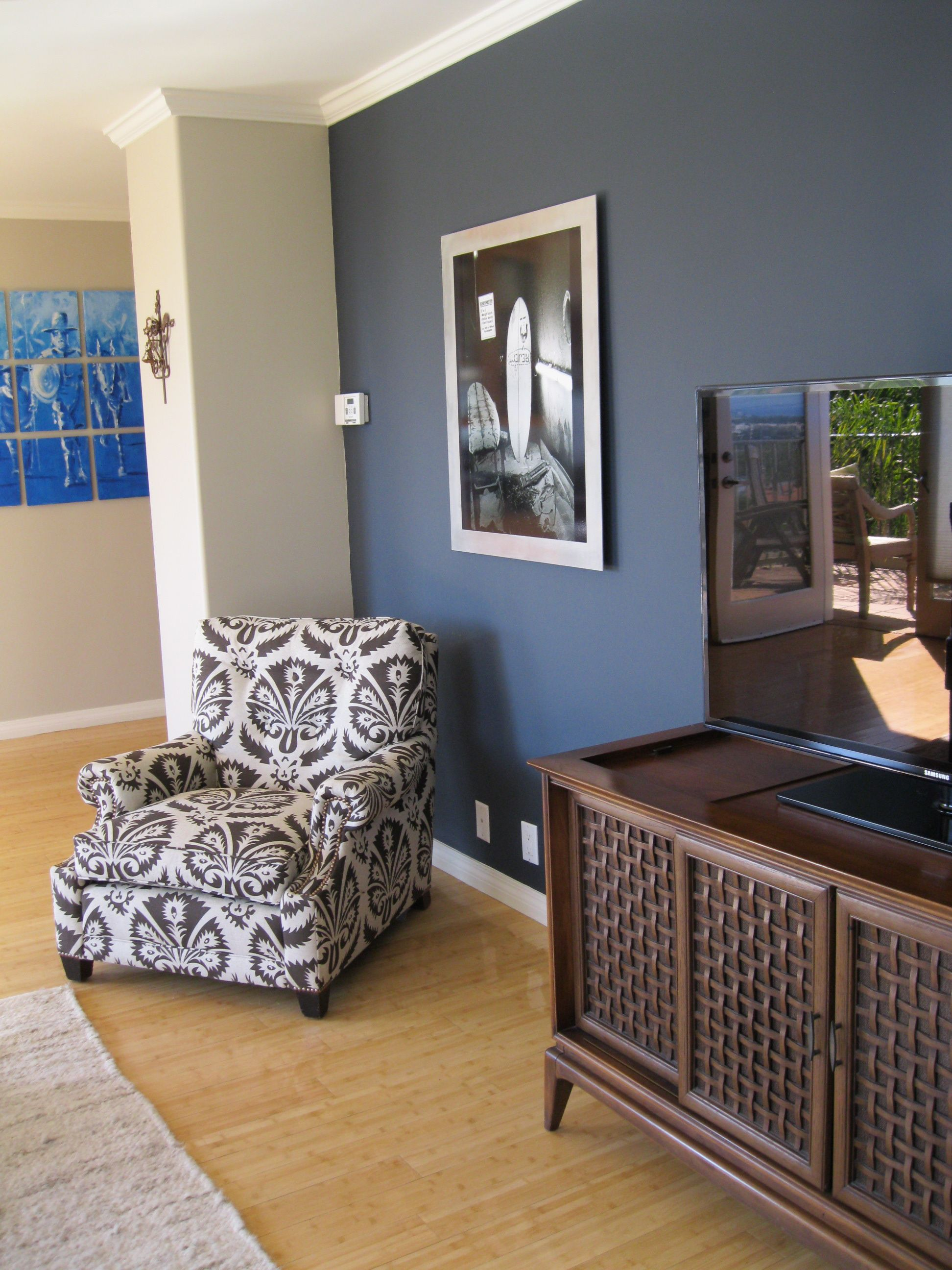 shade of blue on wall camoflauges tv love the chair too. Black Bedroom Furniture Sets. Home Design Ideas