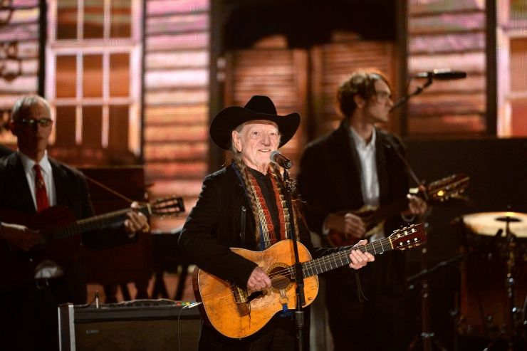 Willie Nelson performs on the 56th Annual GRAMMY Awards on Jan. 26 in Los Angeles