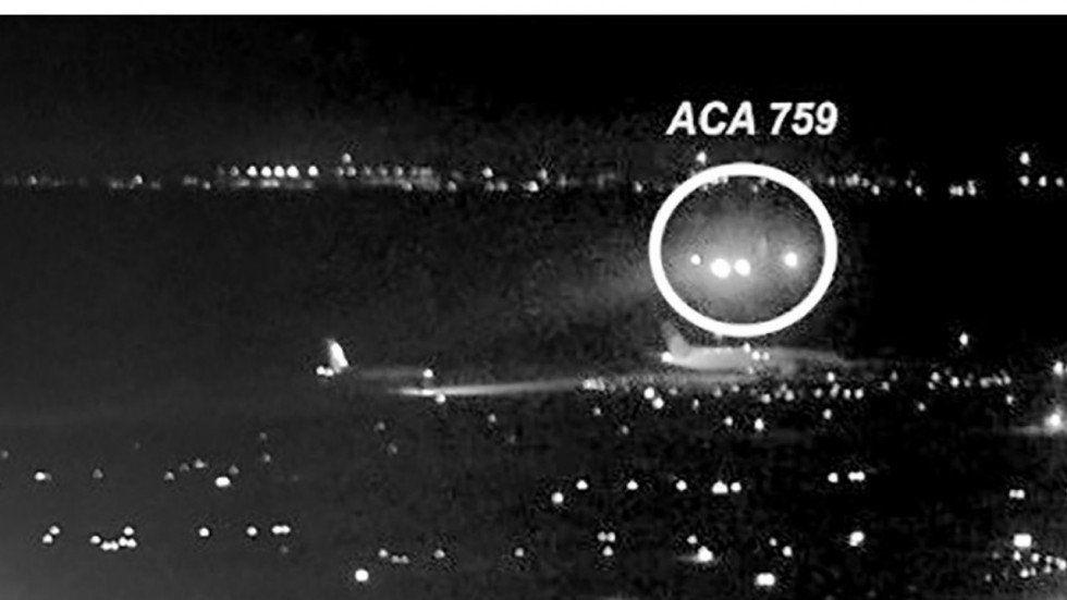 US blames confused pilots after jet almost landed on four