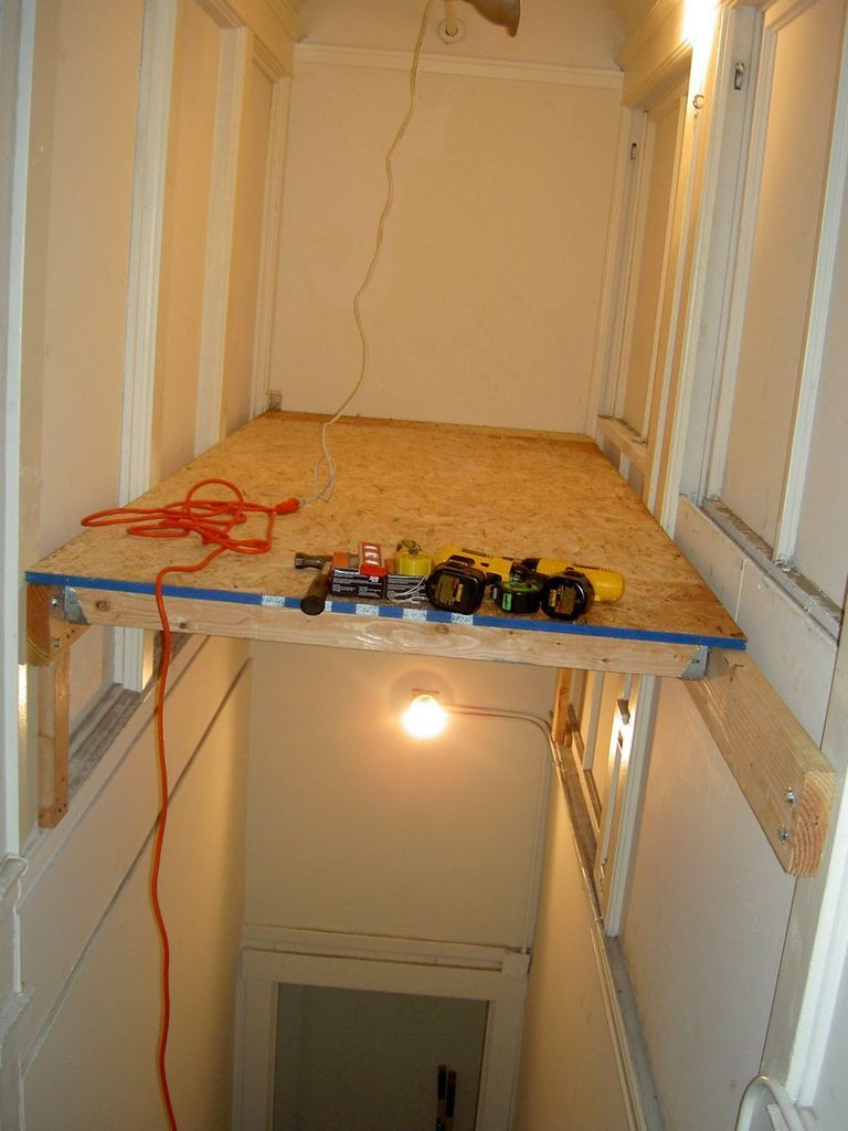 Turn an empty stairwell into a storage loft living space for How much to build a garage with loft