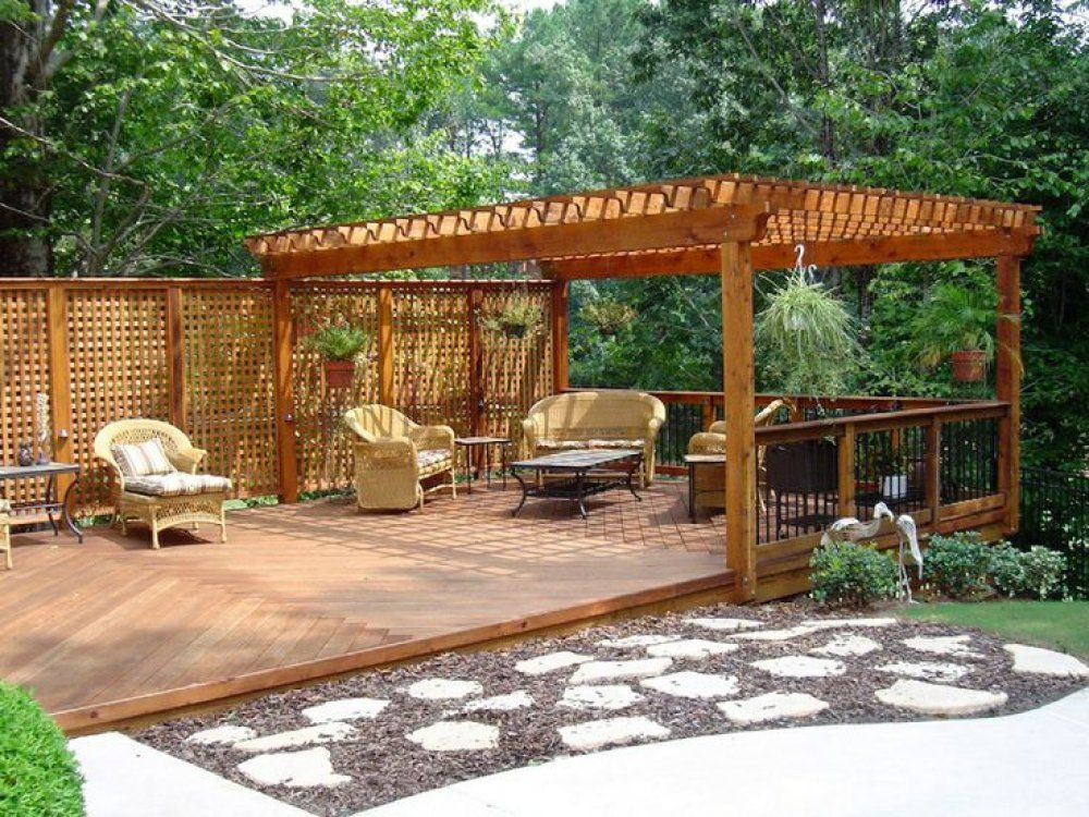 Here S A Ground Level Deck With A Pergola And A Lattice Privacy