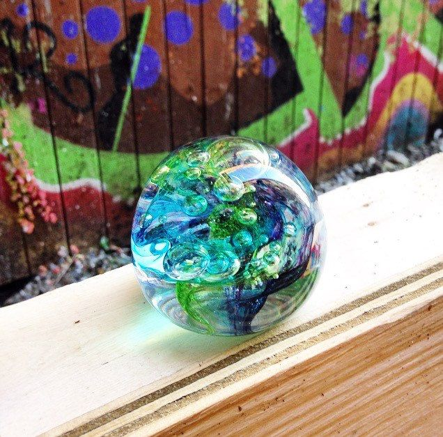 A personal favorite from my Etsy shop https://www.etsy.com/ca/listing/254615109/glass-art-one-of-a-kind-green-blue