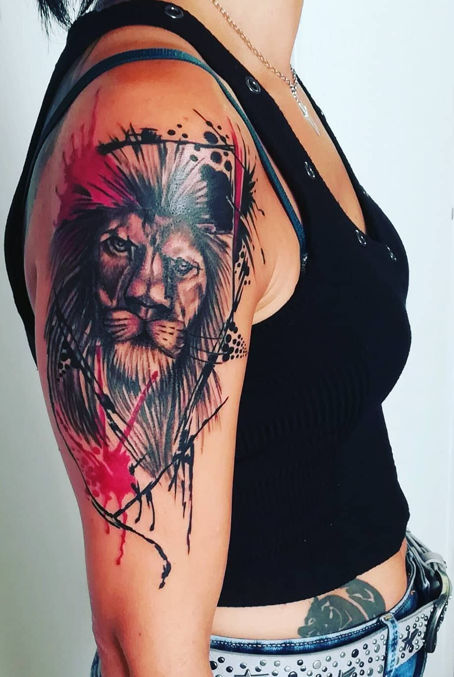 lion trash polka tattoo