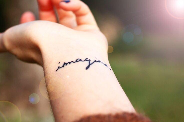 Imagine tattoo on wrist