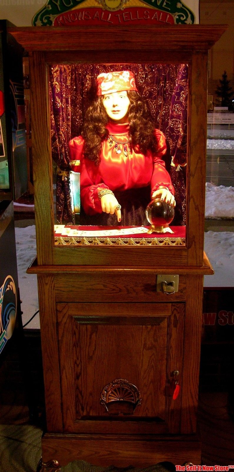 This machine was restored 30 years ago by a local artisan, and most like the cabinet was probably made then and is not orginal.  This machine is coin operated and the gypsy moves her arm, her heart beats and then dispenses a card.  See video:  https://www.youtube.com/watch?v=aSB__ZG5Ots&feature=player_embedded