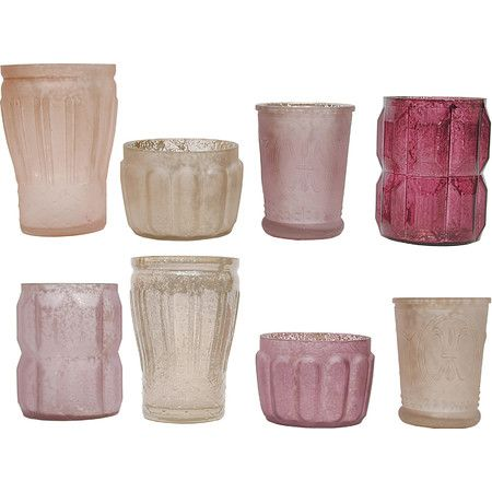Crafted of pink and plum-hued mercury glass, these lovely candleholders look lovely lining the mantel or casting a flickering glow on the sideboard.