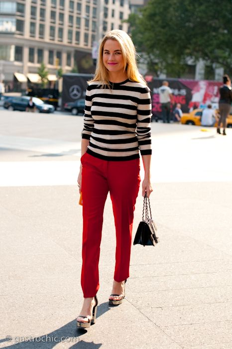 d591aab3b0 Black and white striped sweater -- classic! Love the red pants paired with  it. This color palette is so Parisian chic.