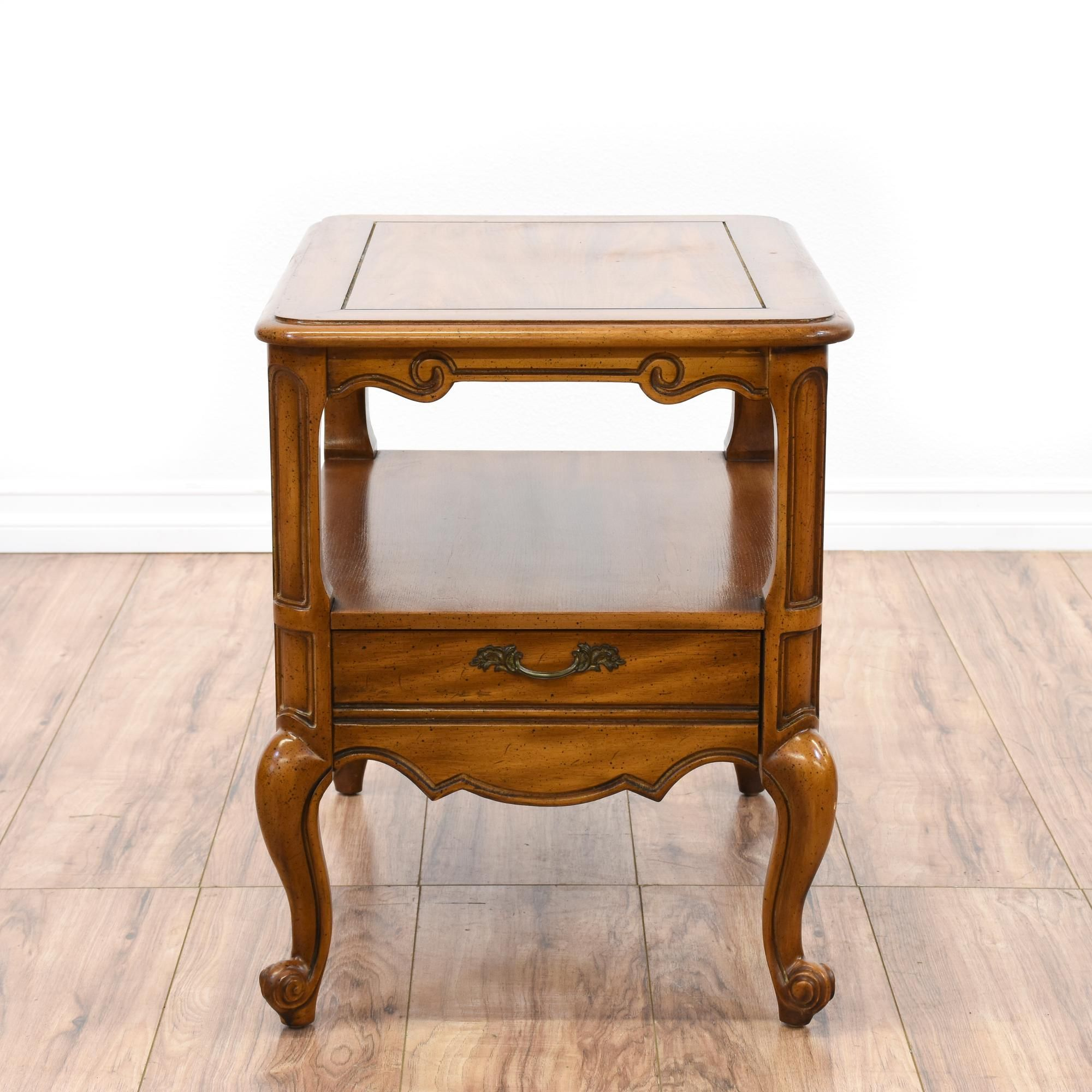 This Weiman end table is featured in a solid wood with a glossy