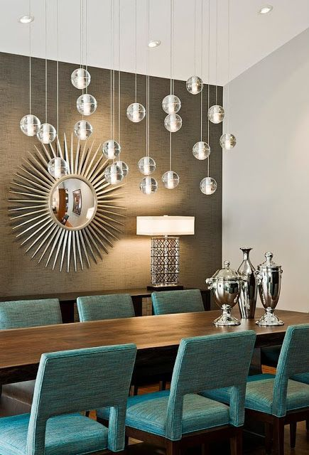 Mid Century Modern Accessories And Chic Teal Chairs Create A Sophisticated  But Nostalgic Dining Room