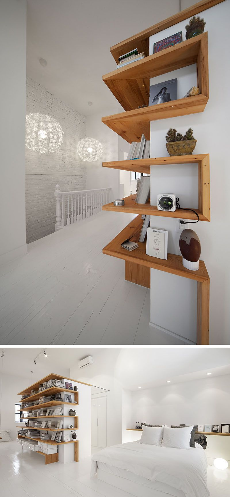 Shelving Design Idea - Shelves That Wrap Around Corners // This loft has wooden shelves that wrap around the central wall to help keep the books, photos, and decor in one place and to keep the rest of the space clean and uncluttered.