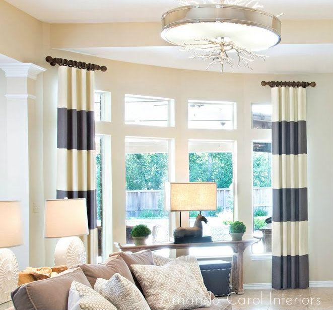 Amanda Carol Interiors.  Horizontal stripe drapery, Global Views chandelier, gray & cream Photography: Laurie Perez http://laurieperez.com/