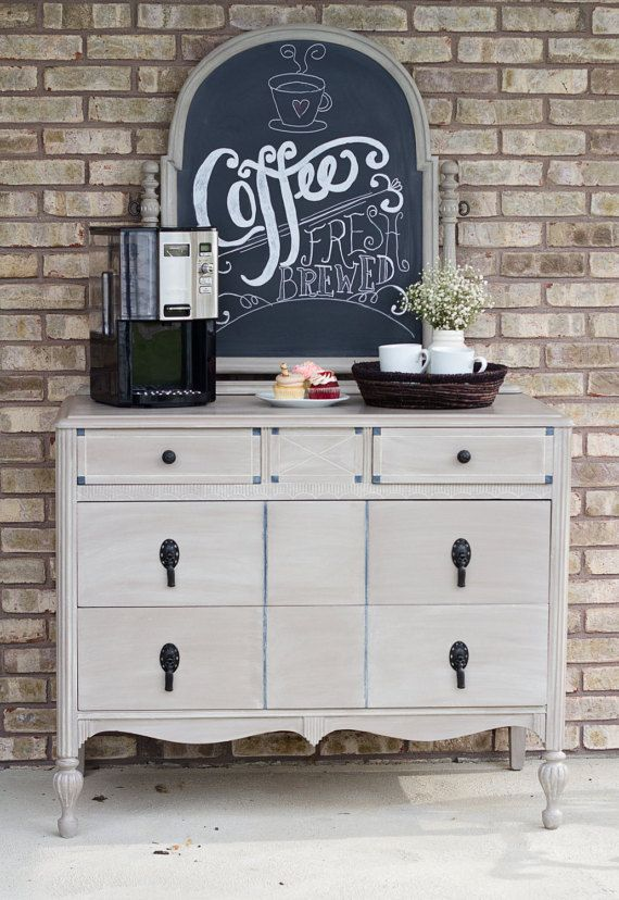 """Why not entertain your friends and family with the ultimate vintage coffee bar? Upcycled vintage dresser turned into a coffee station with 2 large and 2 small drawers with lots of storage for coffee pods, sugar, packets of creamer etc. Painted with Annie Sloan Chalk paint in 'Cocoa """" and an added wash of """" Old Ochre """" to give it some wonderful dimension. The mirror was transformed into a chalkboard so you can add your favorite coffee sayings or seasonal greetings. It's all up to you! Coffee…"""