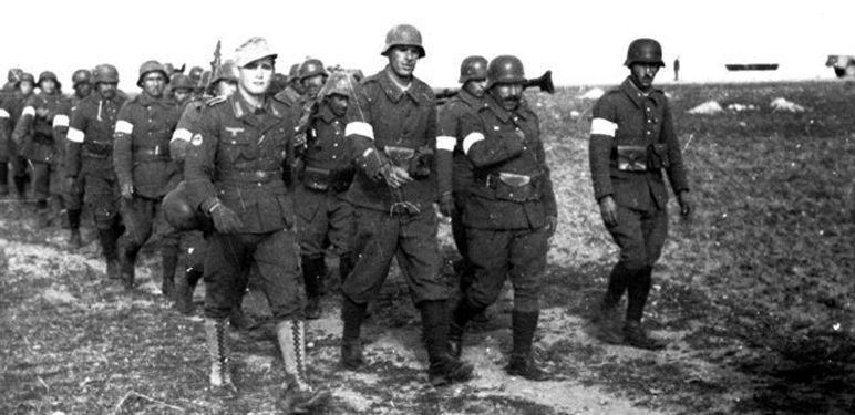 A column of Arab volunteers with German Nazi personnel. Note the white armband, which is pictured below.  WWII