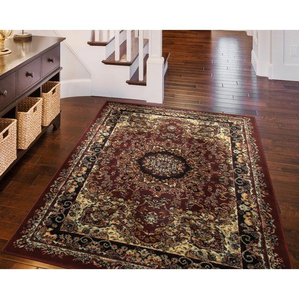 At Andover Mills, value and versatility go hand-in-hand. Featuring a traditional Oriental-style pattern and a rich red-and-black color palette, this rug from our Harrison collection is the perfect blend of familiarity and elegance. Cotton construction offers a soft place to step and is easy to clean.
