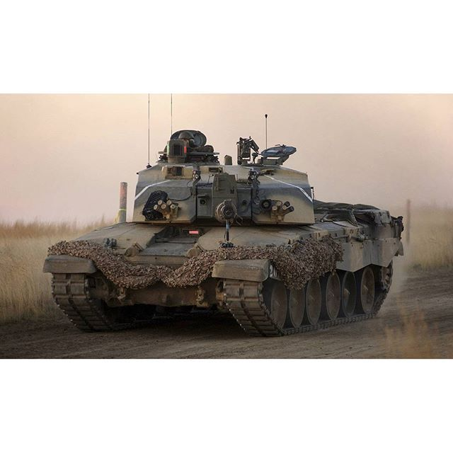 d46686c595a1 British Armed Forces  A Challenger 2 Main Battle Tank thunders at speed  along Rattlesnake road at the British Army Training .