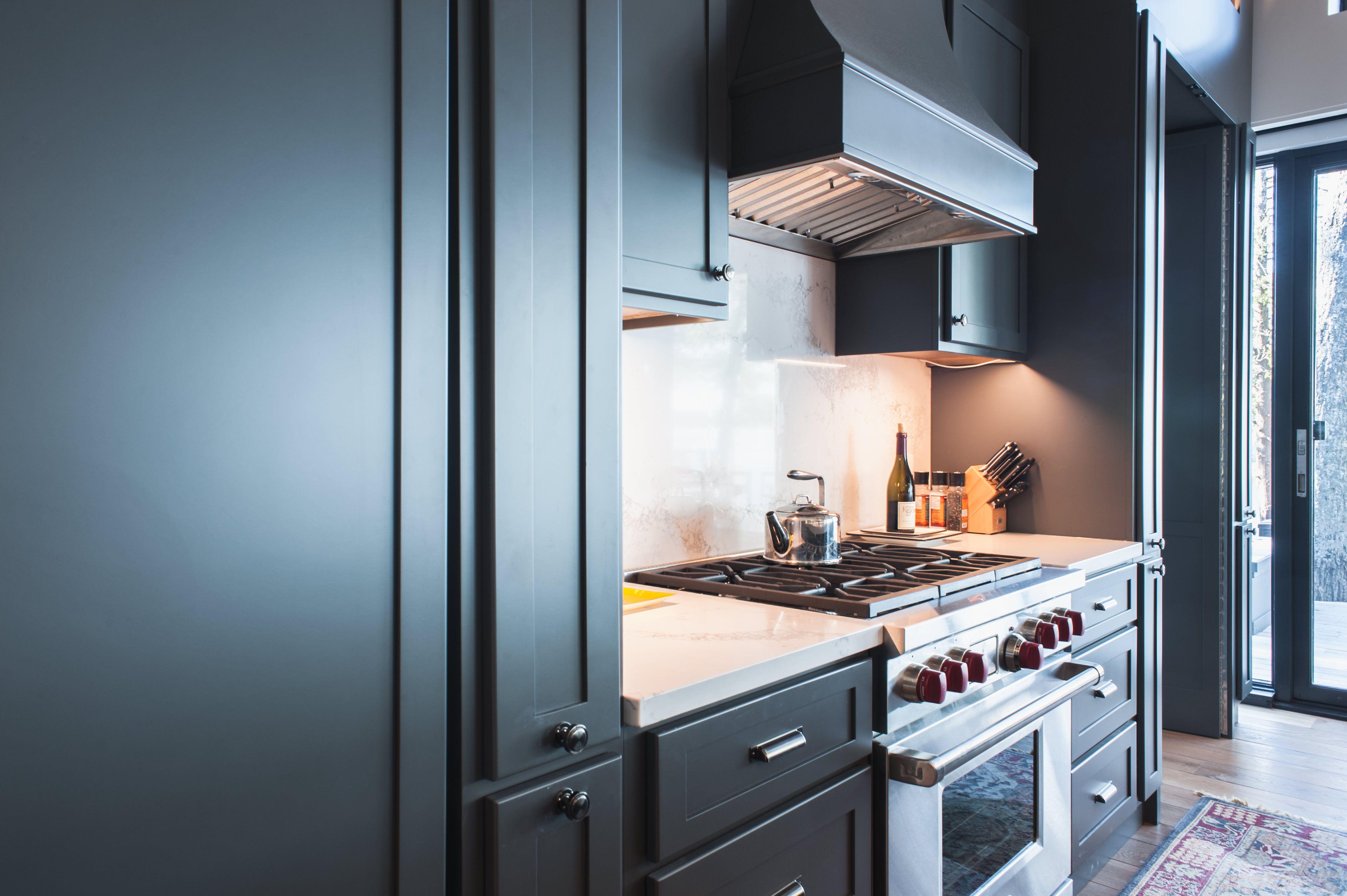 Stunning Cottage kitchen with dark cabinets, white quartz ...
