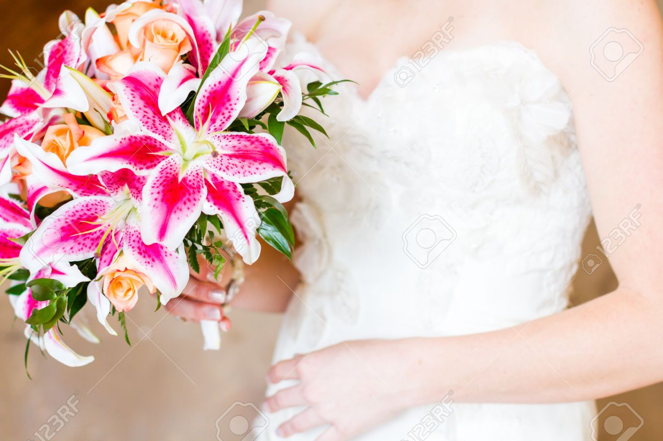 Gorgeous pink bridal bouquet of pink lilies and orange roses ...