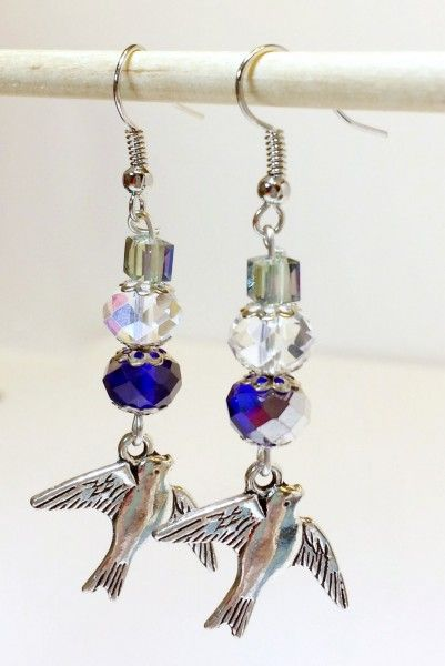 Dangle earrings Blue Crystal and Silver Bird Charms. Hand made, light weight Just under 2 inches long.
