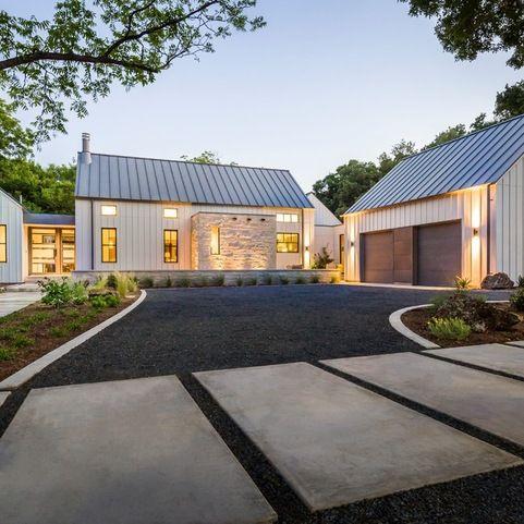 Modern farmhouse in dallas texas farmhouse exterior for Modern farmhouse garage doors