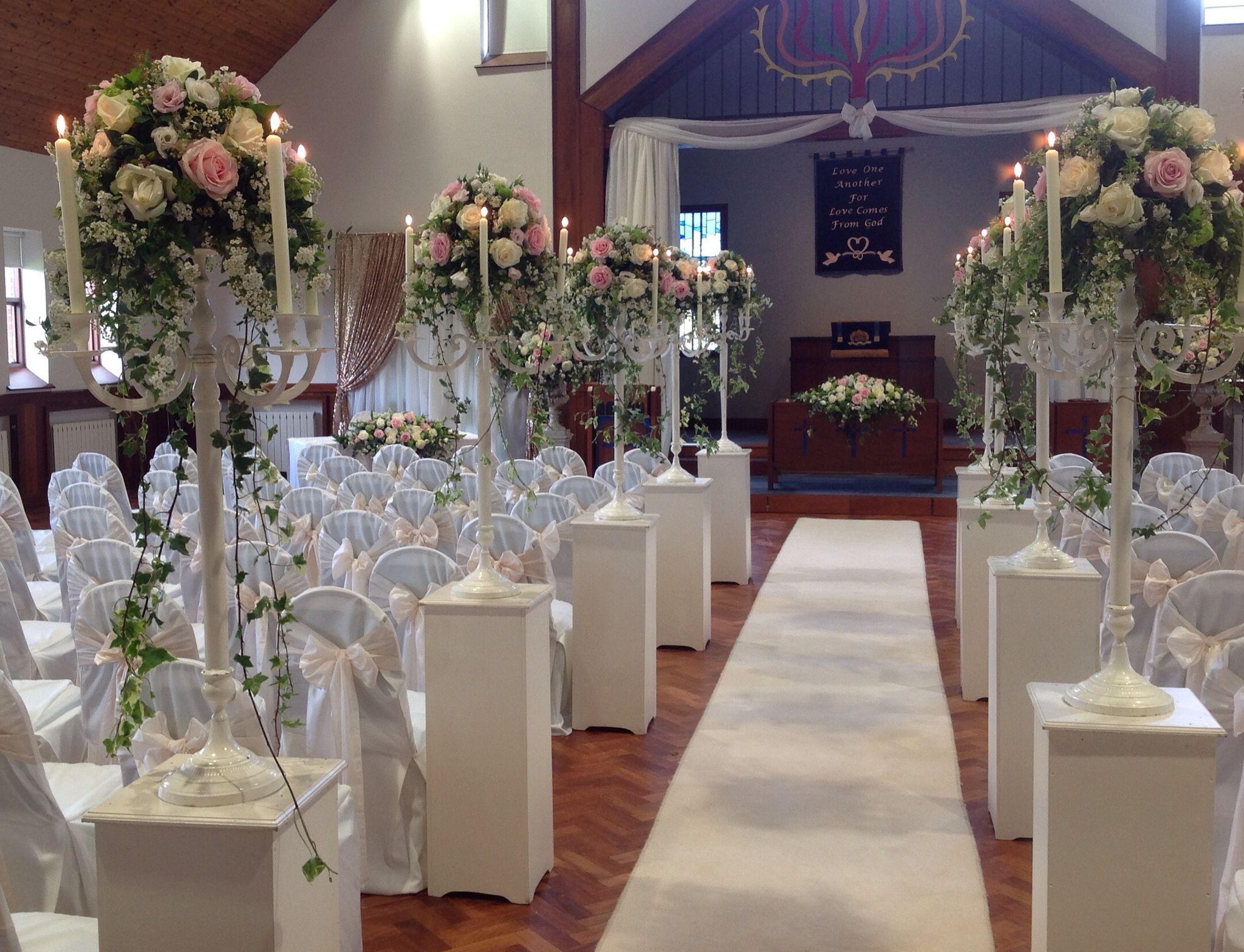 Stunning aisle of flowers by House of Elliott Lisburn