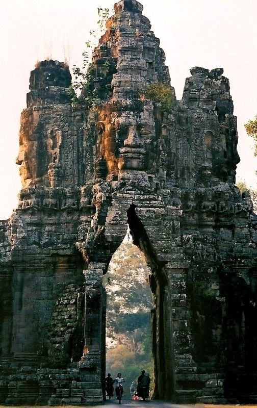 Angkor Thom, Cambodia. This gate is the entrance to the ancient temple complex of Angkor Thom, Cambodia. This image is from a scanned photo taken in 2001.