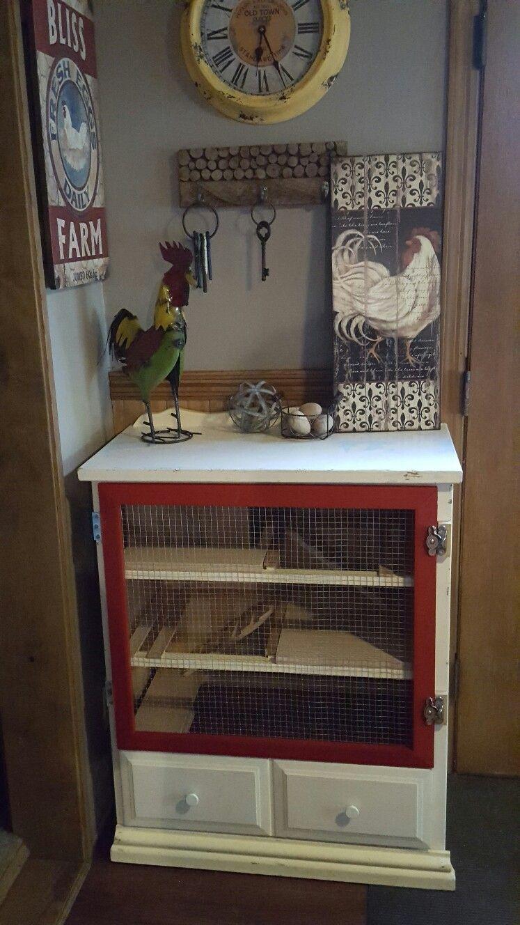 old dresser repurposed into an indoor serama chicken coop