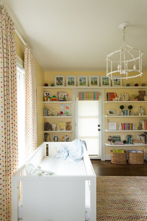 Surrounded By Stacked Floating Bookshelves On Yellow Walls White And Nursery With Pagoda Lantern Over Crib Situated In Front Of Window