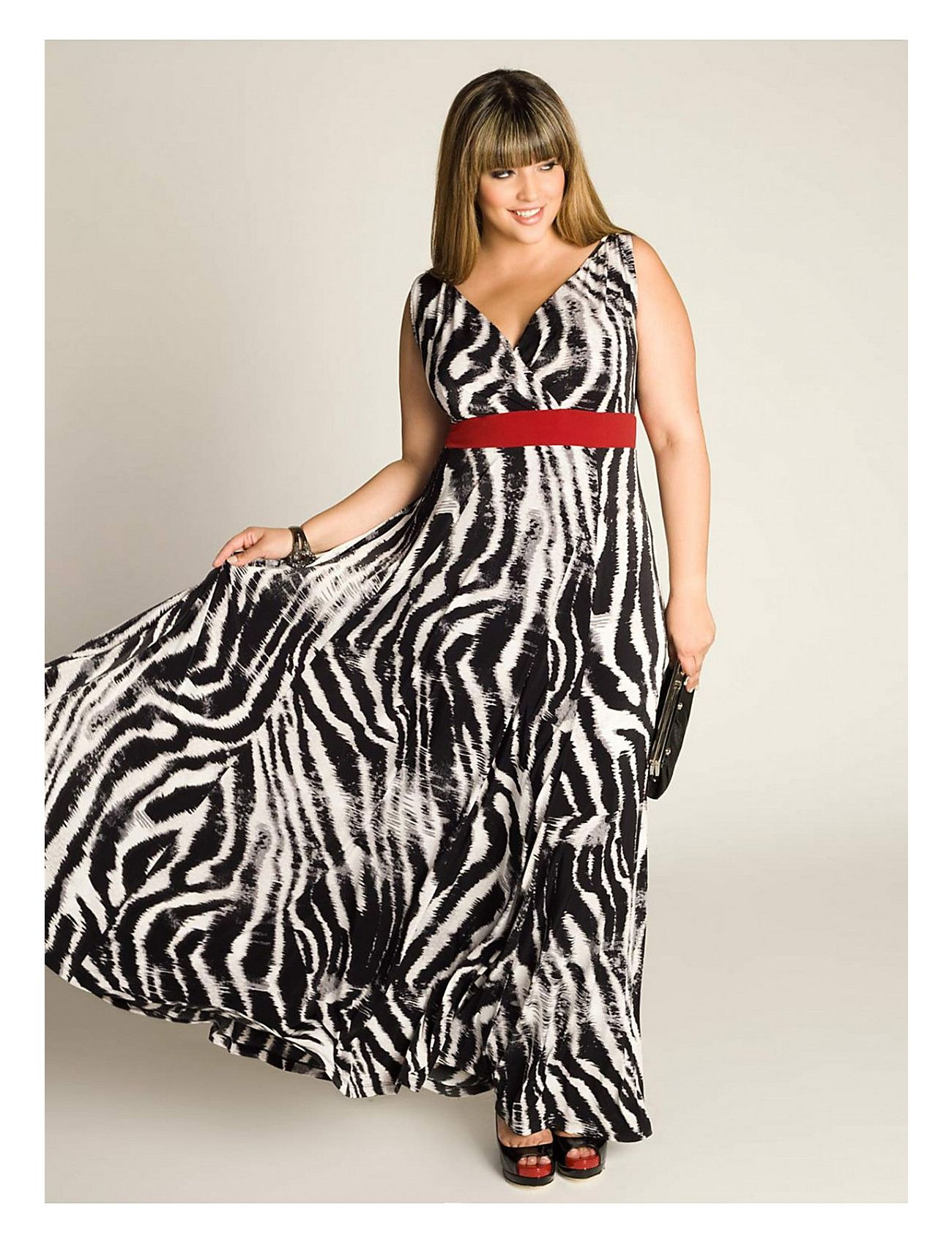 15438226ea4 A fun plus size maxi dress featuring a great zebra print accented with a  red-hot belt from IGIGI by Yuliya Raquel. Perfect for a summer event!