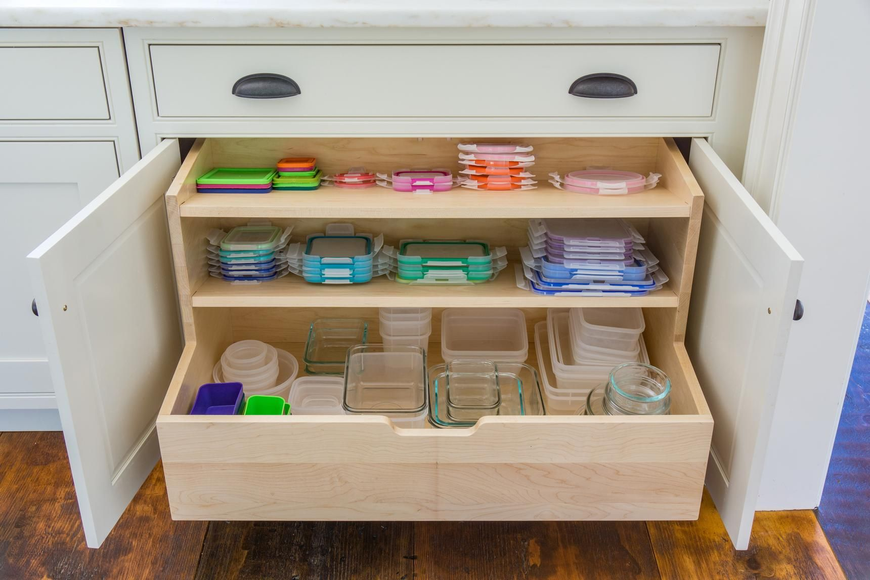 Tupperware And Lids In A Wood Drawer In A Kitchen