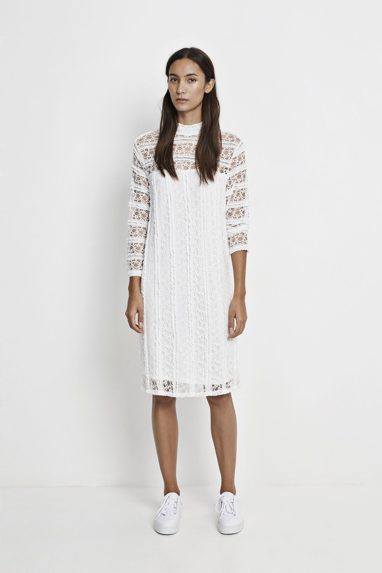 This slim fitting dress has been created in bands of delicate stretch lace  fabric. Three quater length sleeves contrast with the high neckline, which  button ...