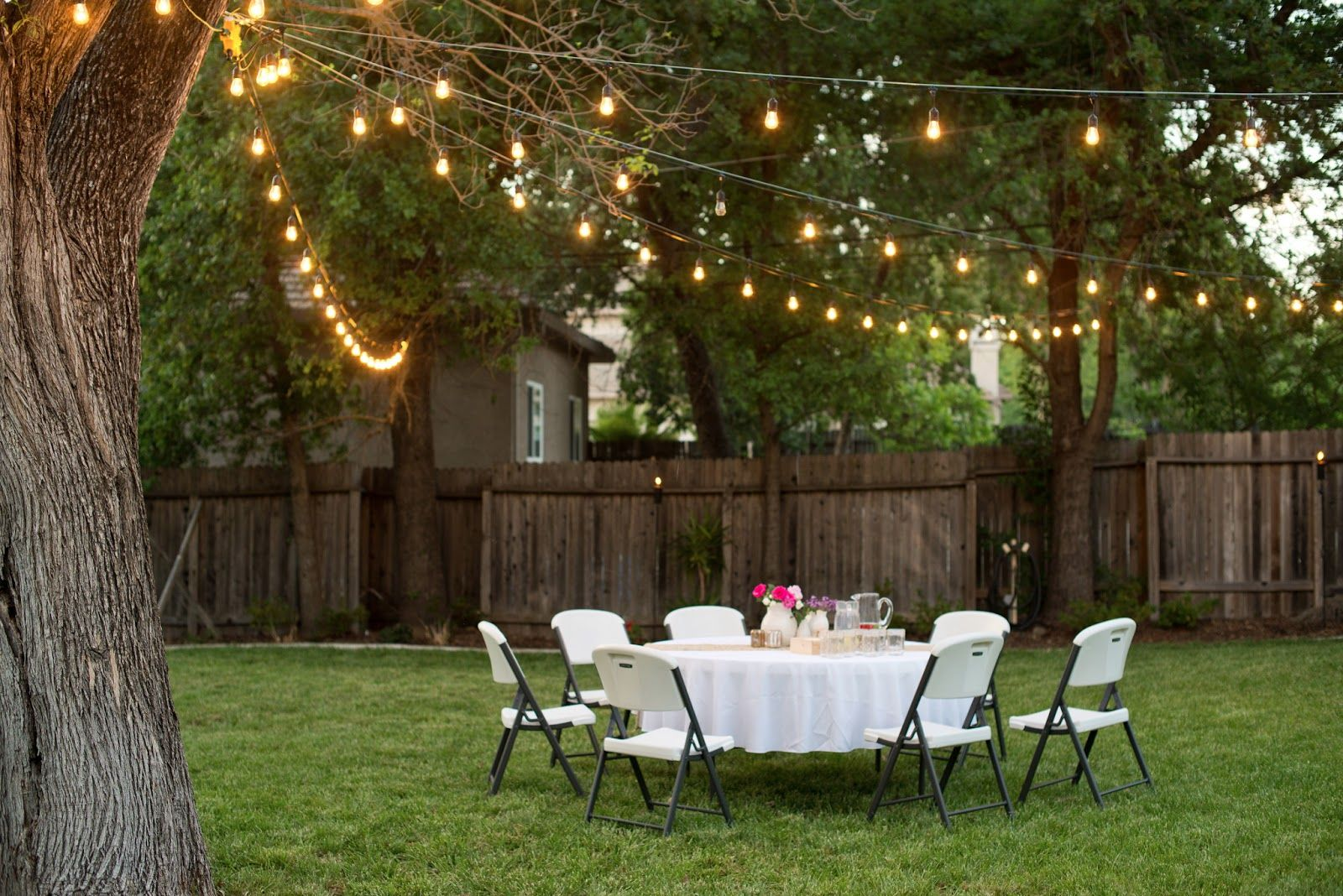 Backyard anniversary dinner party outdoor party lighting