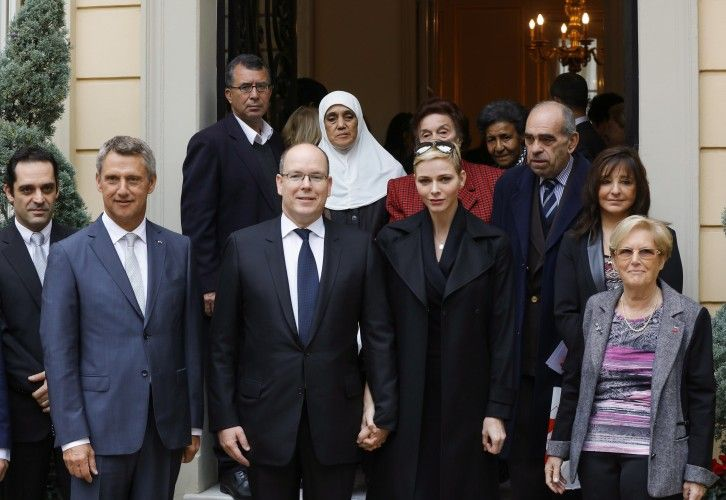 Princess Charlene and Prince Albert handed out presents for the elderly for Monaco Red Cross.