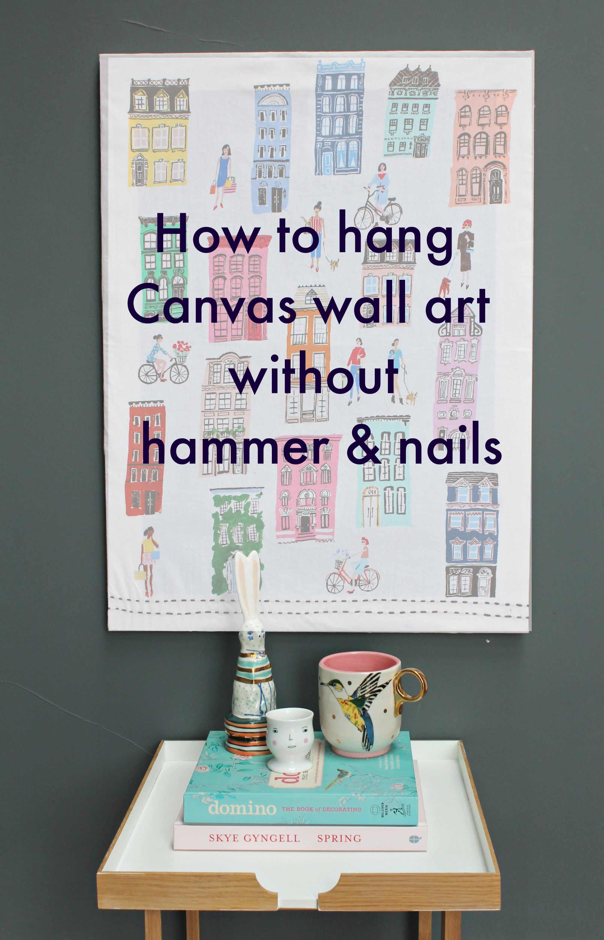 Hang a canvas on a wall without hammer and nails hang