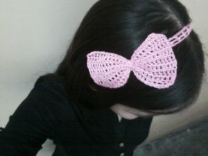 """my monday """"get happy"""" arsenal  a pink crochet bow"""