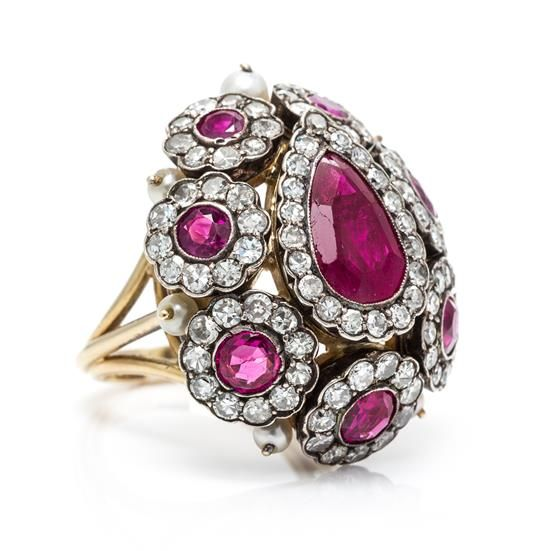 A Silver Topped Gold, Ruby, Pearl and Diamond Dome Ring.