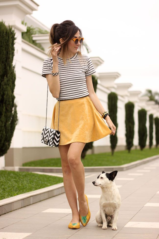 Black and white outfit with a pop of colour in this yellow skirt and some funny accessories.