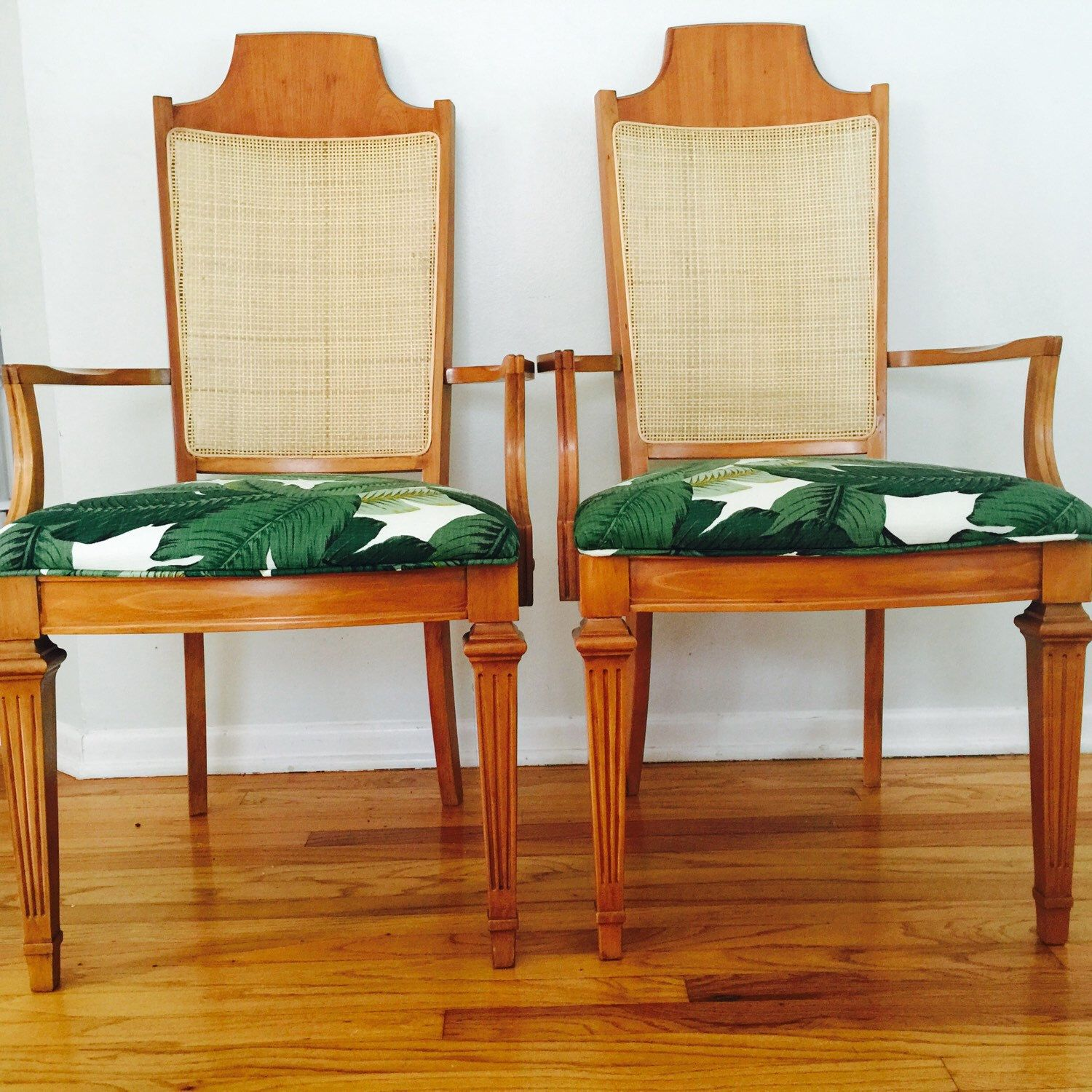 A personal favorite from my Etsy shop https://www.etsy.com/listing/221650566/reupholstered-palm-leaf-dining-chairs