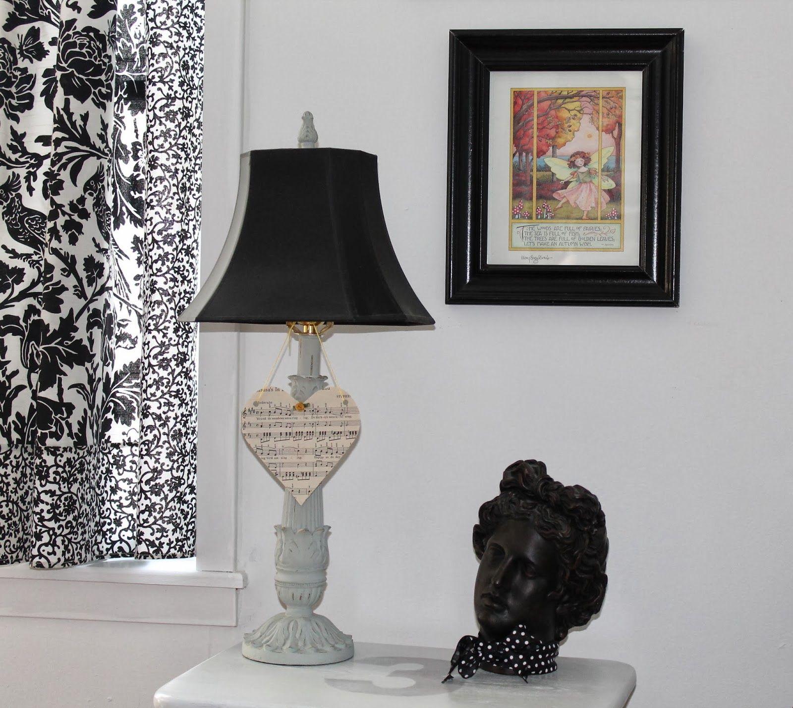 Black frames against white walls makes art work pop