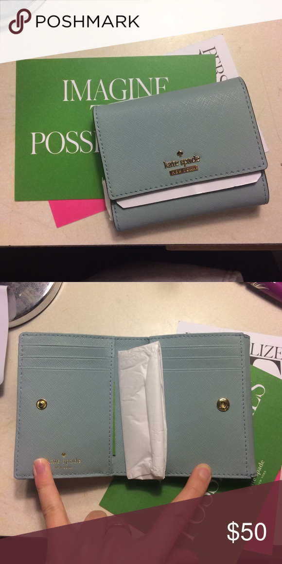 New Kate spade wallet! Blue with a tint of gray wallet never used! Price negotiable! kate spade Bags Wallets