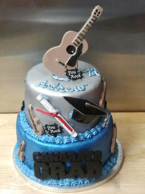 Graduation Cake for a young man that loves music Scooters Cake